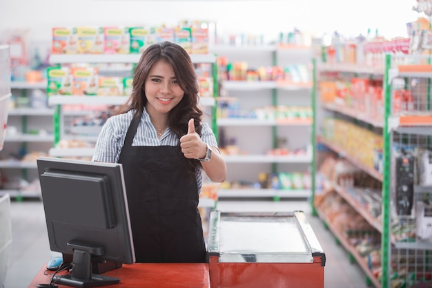 Cashier showing thumb up
