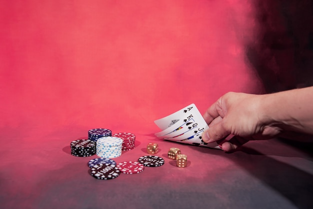 Casino abstract photo. poker game on red background.  theme of gambling.