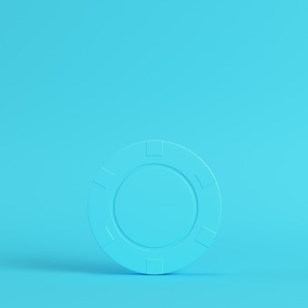 Casino chip on bright blue background