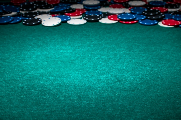 Casino chips on green gambling table
