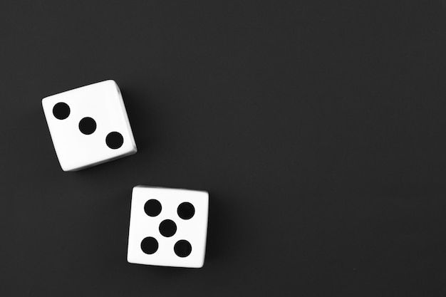 Casino dices on the black background