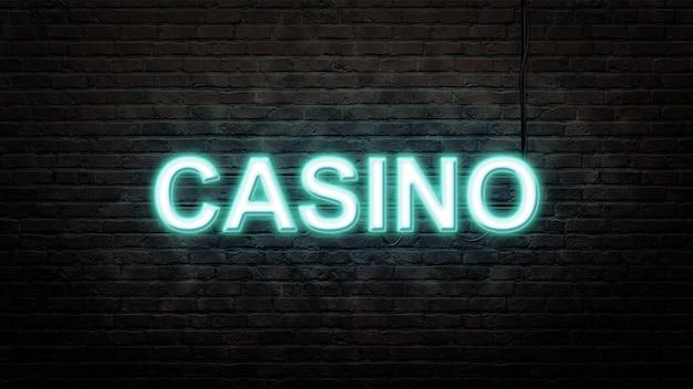 Эмблема неоновая вывеска казино в неоновом стиле на фоне кирпичной стены