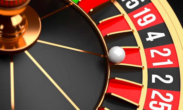 Casino roulette wheel with white ball