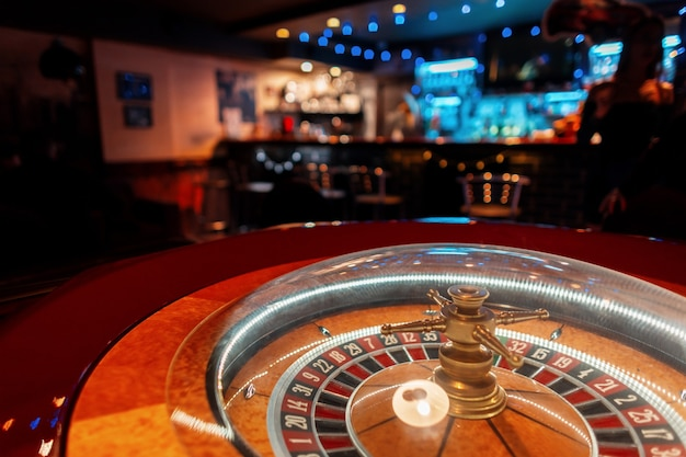 Casino roulette with wooden golden table in the bar