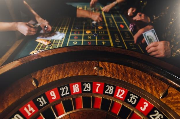 Casino theme.  unrecognisable gamblers play casino on money.
