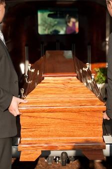 Casket carried by coffin bearer