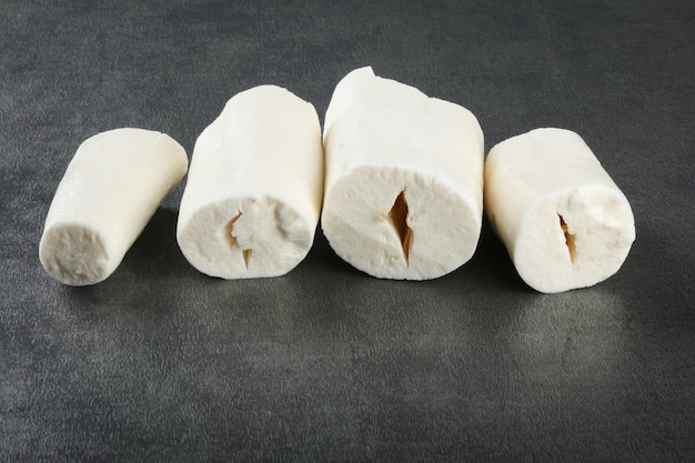 Cassava pieces isolated on dark background..