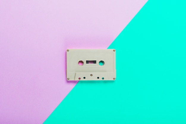 Cassette tape on dual purple and turquoise background