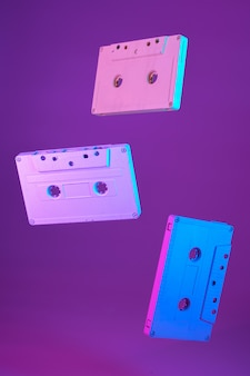 Cassette tape vintage style suspended in air on purple background