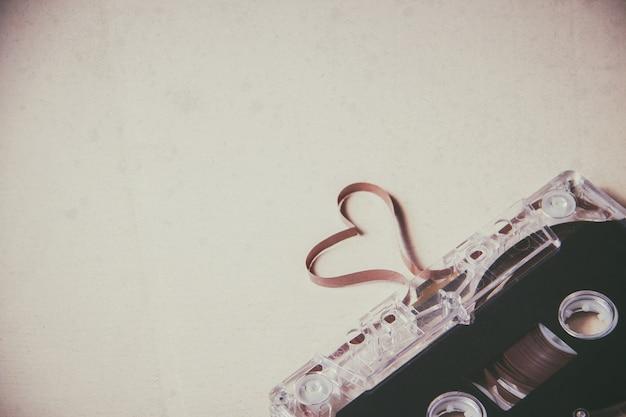 Cassette tape on wooden. film shaping heart