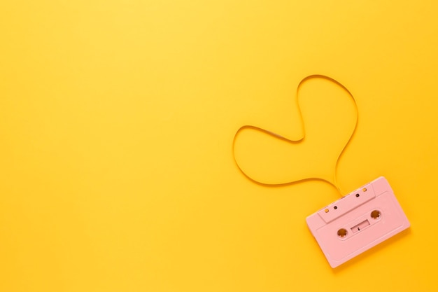 Cassette on yellow background with copy space