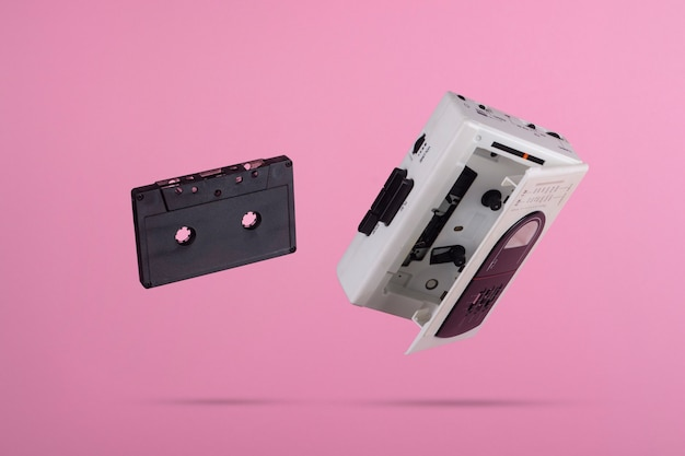 Cassettes floating on a pink background