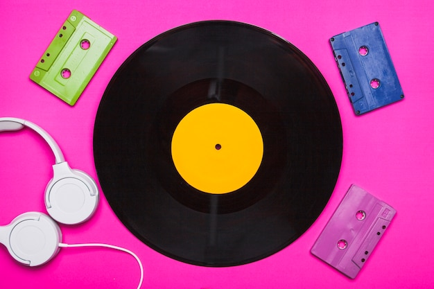 Cassettes and headphones around disc