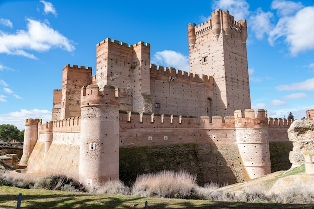 Castle of la mota under the sunlight and a blue sky at daytime in medina del campo, spain