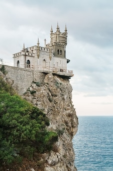 Castle on a rock at the cliff near the sea