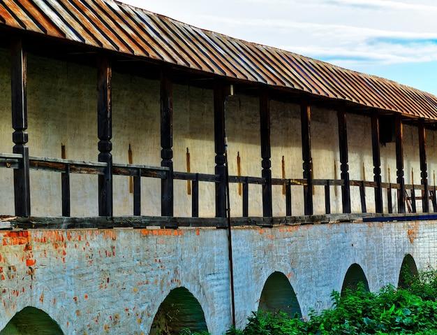 Стена замка с фоном архитектуры арок