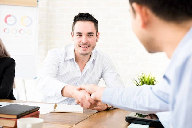Casual businessmen making handshake