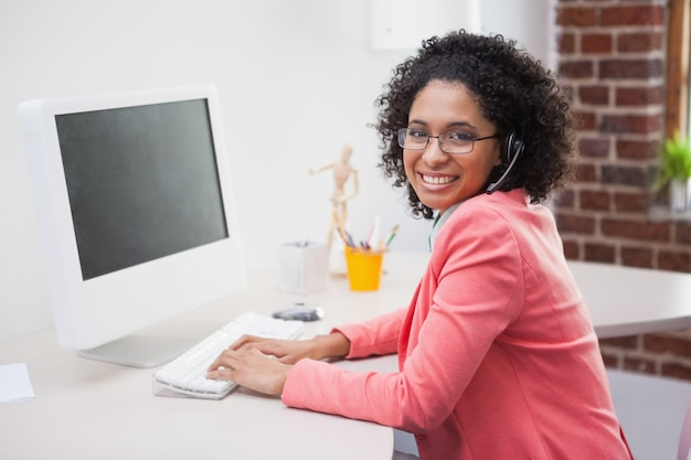 Casual businesswoman working on computer