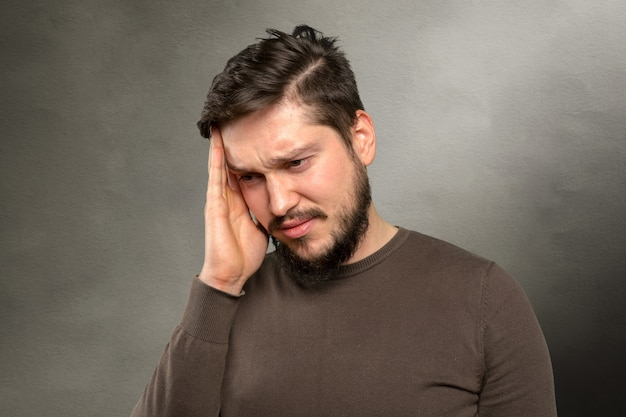 Casual caucasian  young man suffering from headache