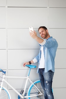Casual guy taking a photo with the mobile