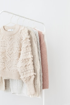 Casual knitted sweaters hanging on a rack