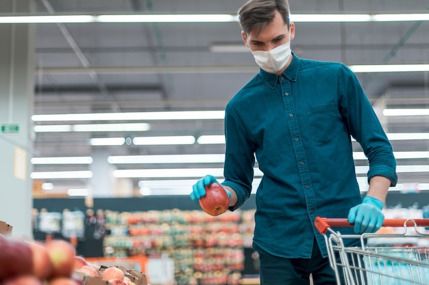 Casual man buying fruit in the quarantine period. security concept