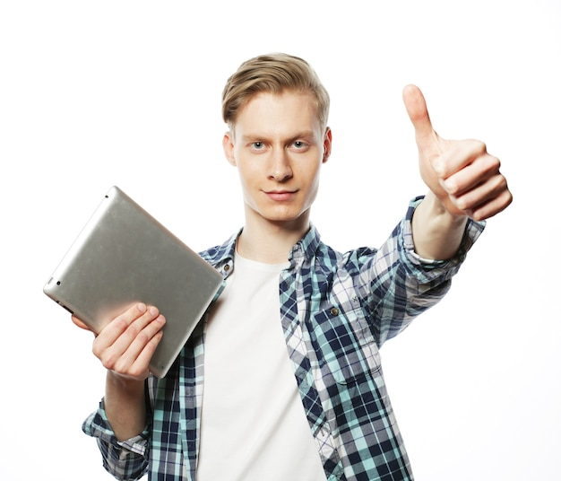 Casual man with tablet pad computer making the ok thumbs up hand sign