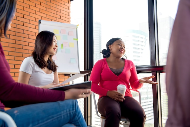 Casual multiethnic women meeting for social project
