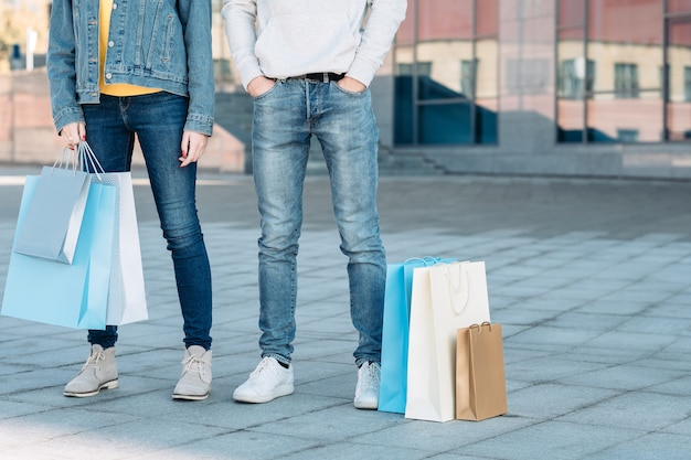 Casual shopping couple sale consumerism man and woman with paper bags