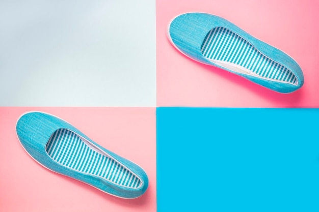 Casual summer footwear on pink and blue background. women or teenage fashion