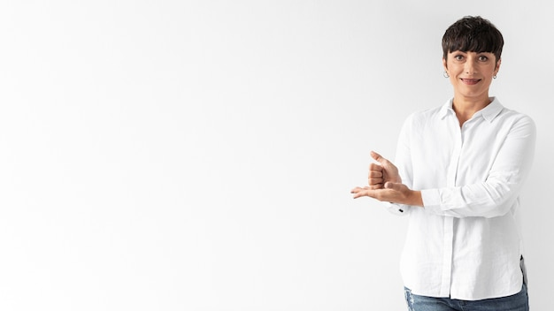 Casual woman teaching sign language with copy space