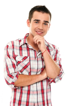 Casual young man posing with hand on chin