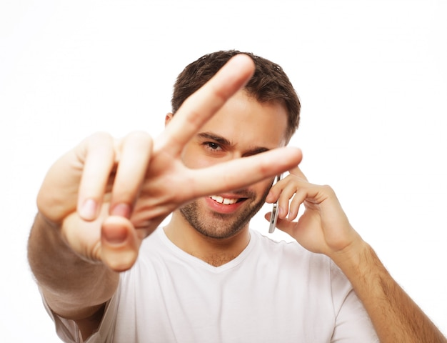 Casual young man showing thumbs up sign