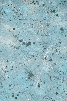 Casually painted background with splashes of blue color.