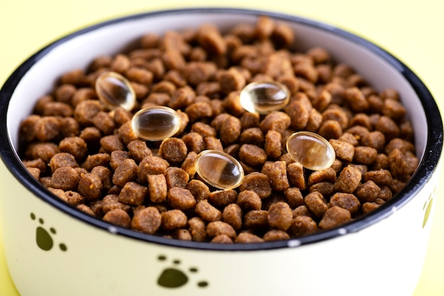 Cat food with tablets in a bowl