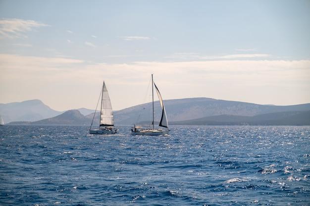 Catamaran sail yacht cruising on deep blue sea water