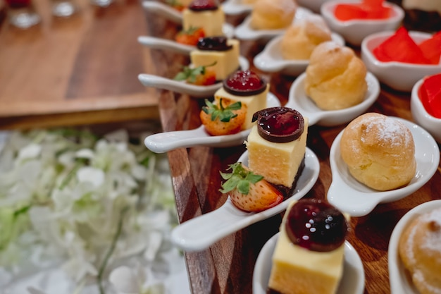 Catering dessert line in wedding ceremony