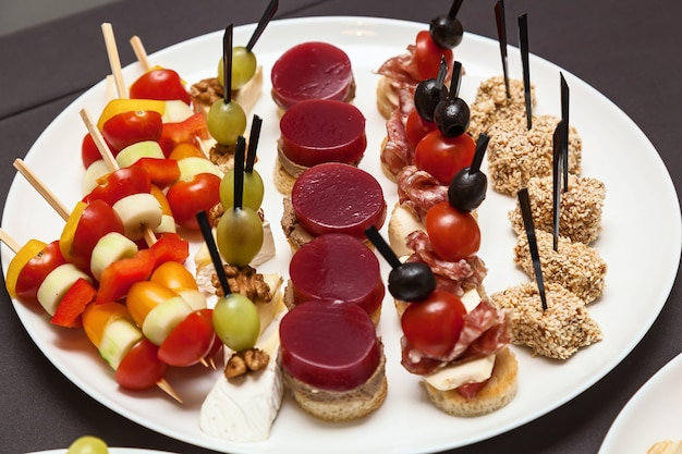 Catering food for holidays and events various cold snacks on croissants for a buffet table