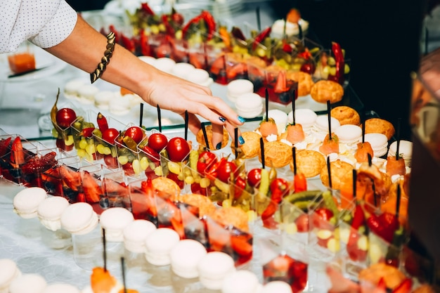 Catering services. buffet with sea food. canapes with red fish, shrimp sauce, small sandwiches.