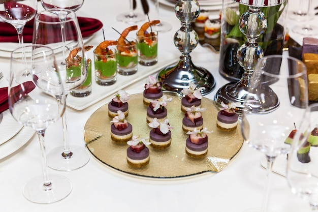 Catering, various delicious snacks on buffet plates.