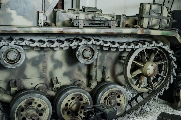 Caterpillars of the old camouflage tank