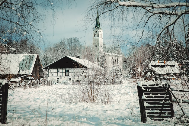 Catholic church in a snow after snowfall in europe