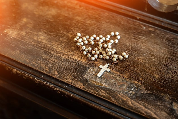 Catholic cross in the church on the old table.
