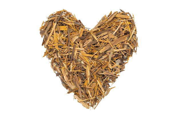 Catuaba bark tea, isolated heart-shaped. natural herbal tea from powdered catuaba tree bark.