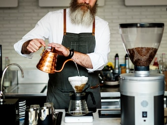 Caucasian barista man making drip coffee