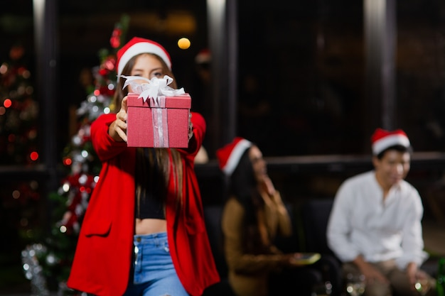 Caucasian beautiful girl holding gift boxes christmas party