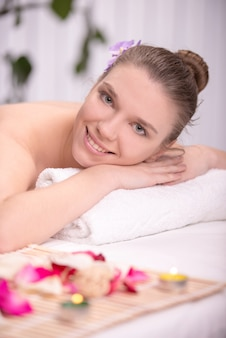 Caucasian beauty taking a rest in the spa.