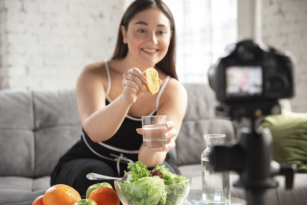 Caucasian blogger makes vlog how to diet and lost weight