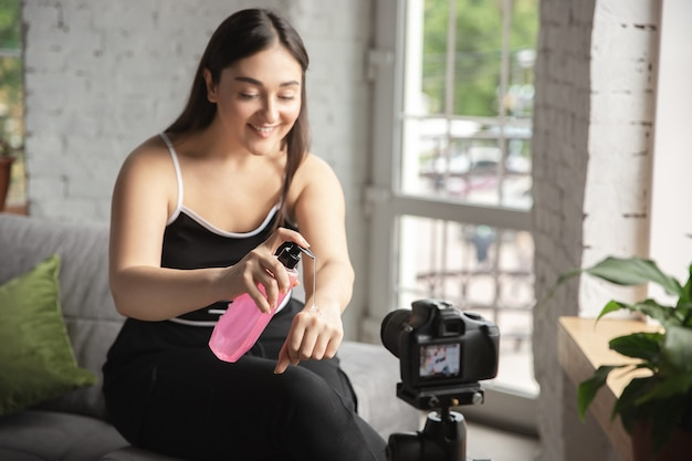 Caucasian blogger woman makes vlog how to be body positive and taking beauty treatment