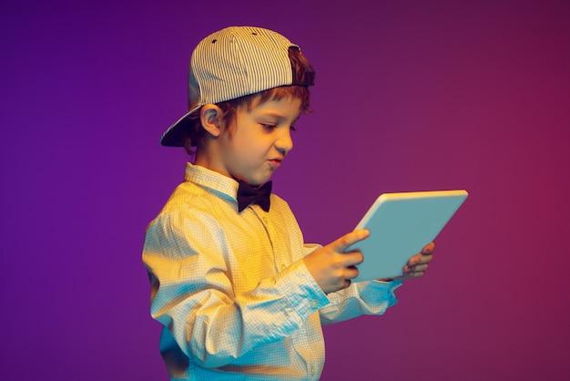 Caucasian boy's portrait on in neon light